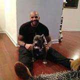 Boozer sitting with his dog